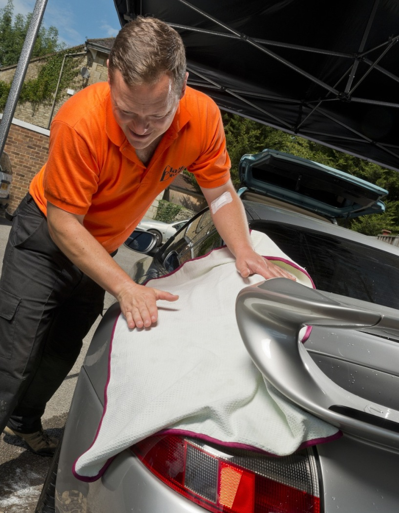 Rich using a specialist drying towel to ensure there is no paint marring
